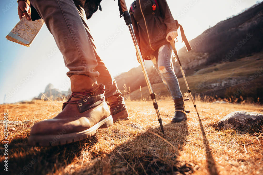 Fototapety, obrazy: Hiking man and woman with trekking boots on the trail