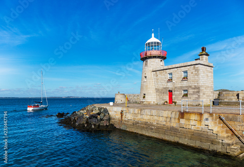 Historic lighthouse at the harbor of Howth near Dublin, Ireland Wallpaper Mural
