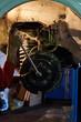 Car mechanic repairing brakes disc on car, indoor repair service