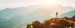Leinwandbild Motiv Mountain hiker with backpack tiny figurine stay on mountain peak with beautiful panorama