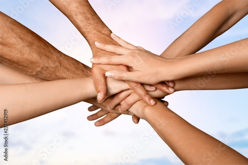 Fototapety, obrazy: Family holding their hands together in shape of sun with sky on