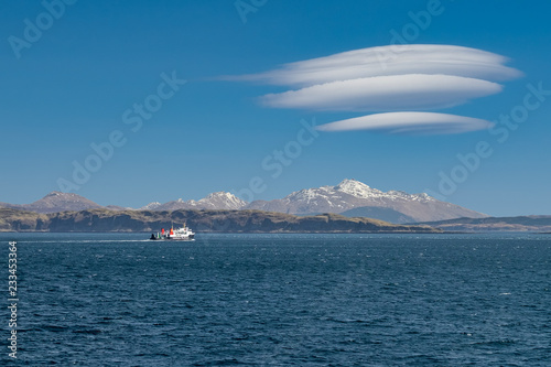 Fotografie, Obraz  Ferry sailing between Oban and the Isle of Mull with snow capped highland peaks