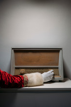 Hand Of Santa Claus In Glove And Coat On Vintage Radio Receiver