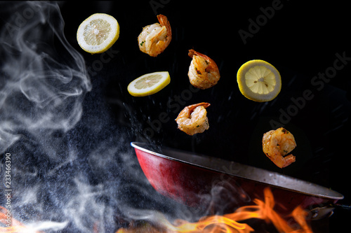 Fotografie, Obraz  Tossing Cooking Lemon Shrimp
