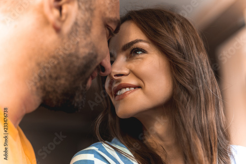 Fotografie, Obraz  Close up of beautiful happy couple in love looking to each other very tenderly w