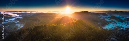 Sunrise over Bieszczady Mountains in Poland. Aerial panoramic landscape.