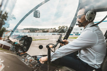 Serious Professional Pilot Sit...
