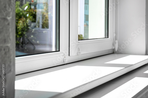Modern window indoors, closeup view. Home interior