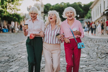 Waist Up Photo Of Old Stylish Women. White-haired Females Holding Each Other And Laughing