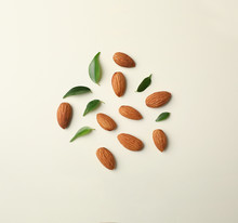 Composition With Organic Almond Nuts On Light Background, Top View