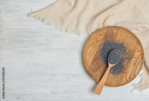 Foto op Canvas Aromatische Flat lay composition with poppy seeds and space for text on white wooden background