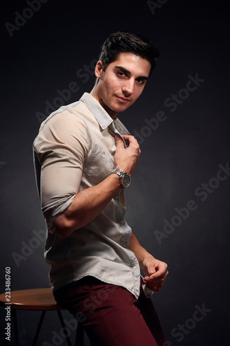 Fototapety, obrazy: one young handsome man, handsome model, 20-29 years old, posing in studio, photo shoot. black background. casual clothes. wearing jeans shirt.