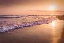 Sunrise At Sea On The Coast Of...