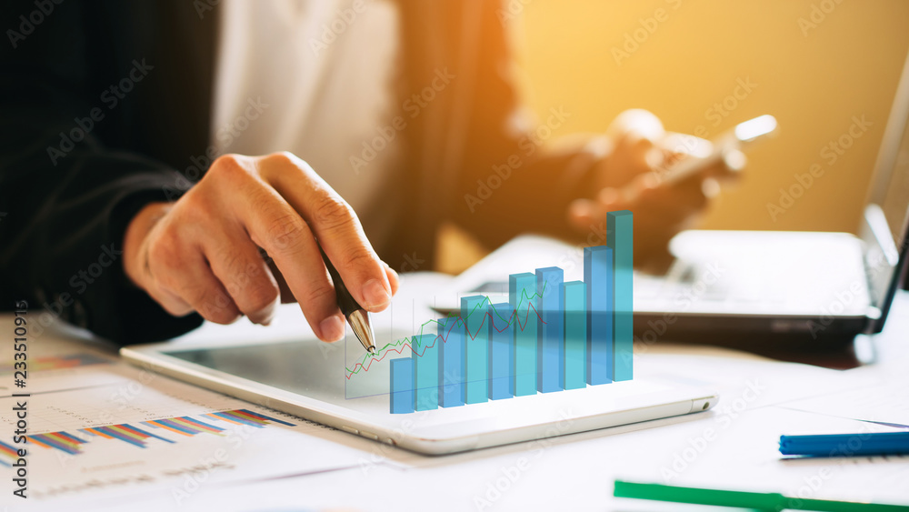 Fototapeta businessman investment consultant analyzing company financial report balance sheet statement working with digital graphs. Concept picture for stock market, office, tax,and project. 3D illustration.