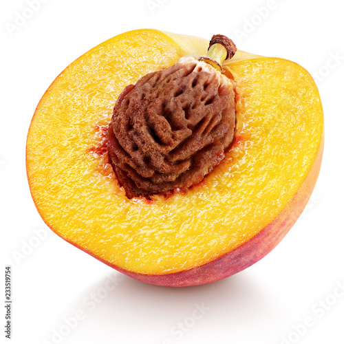 Ripe half peach fruit with nut isolated on white background with clipping path. Full depth of field.