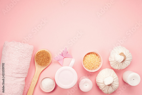 Poster Spa Feminine beauty and spa products, tools and cosmetics over the pink background