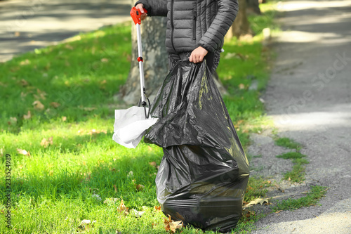 Photo  Woman gathering trash in park