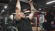 Man pulls himself up on a horizontal bar, strength training.