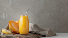 Pumpkin Smoothie With Apple And Cinnamon In Glass