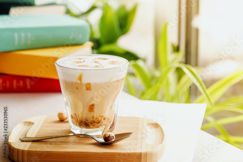 Fototapeta  A coffee drink with caramel and pattern on the foam