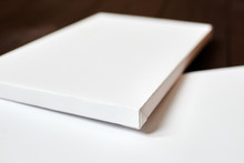 Two White Blank Canvases On Brown Wooden Background. Mockup