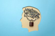 Profile Of Man With Brain In The Form Of Chain And A Closed Lock. Privacy Policy