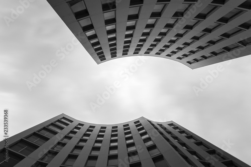 Unusual modern building and cloudy sky