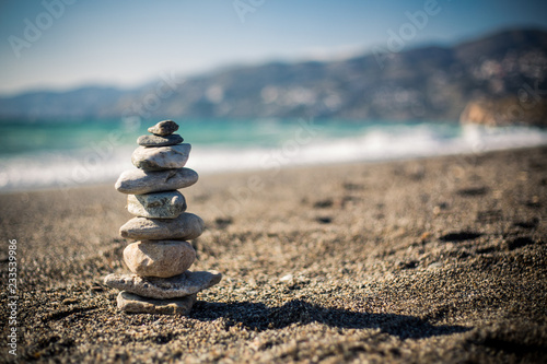 Stone tower on beach