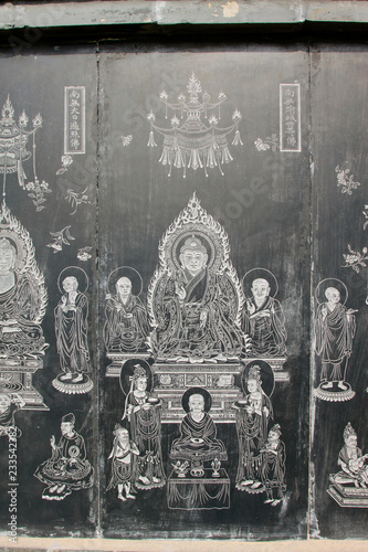 Photo Stands Illustration Paris Exquisite statues carved on the black marble in Jijue Temple, China