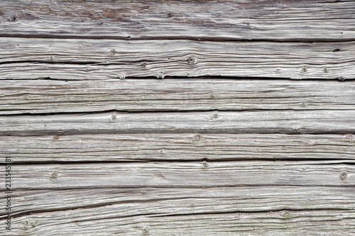 Fotografiet  Light gray, old weathered wooden wall with horizontal lines as background