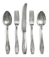 Vintage Cutlery, Silverware. Old Silver Cutlery, Isolated On White Background. Top View Of Table Knife, Fork And Spoon With Ornament Details.