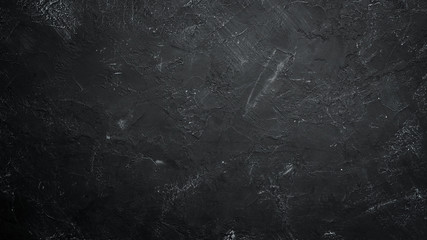 Black stone background. Black surface. Top view. Free space for your text.
