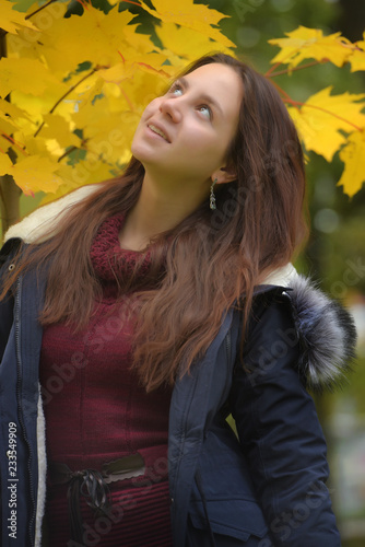 long-haired brunette teenager with a blue jacket