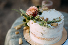 Romantic Rustic Pastel Floral Design Of Wedding Cake On A Table Outdoors