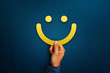 Hand of client show a feedback with smiley face sign. Service rating, satisfaction concept