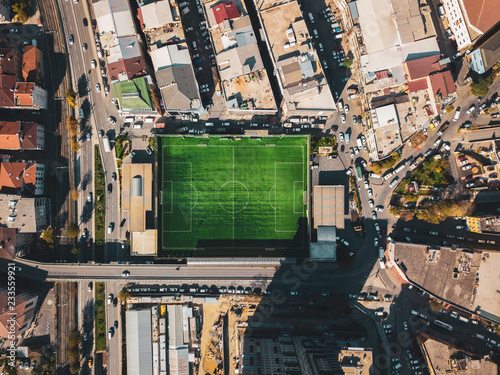 Obraz aerial view of a football field in residental area. top view of football pitch - fototapety do salonu