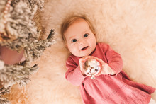Smiling Baby Girl With Christm...