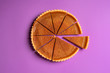 canvas print picture - Sliced pumpkin pie and a separate piece. Top view. Traditional dessert.