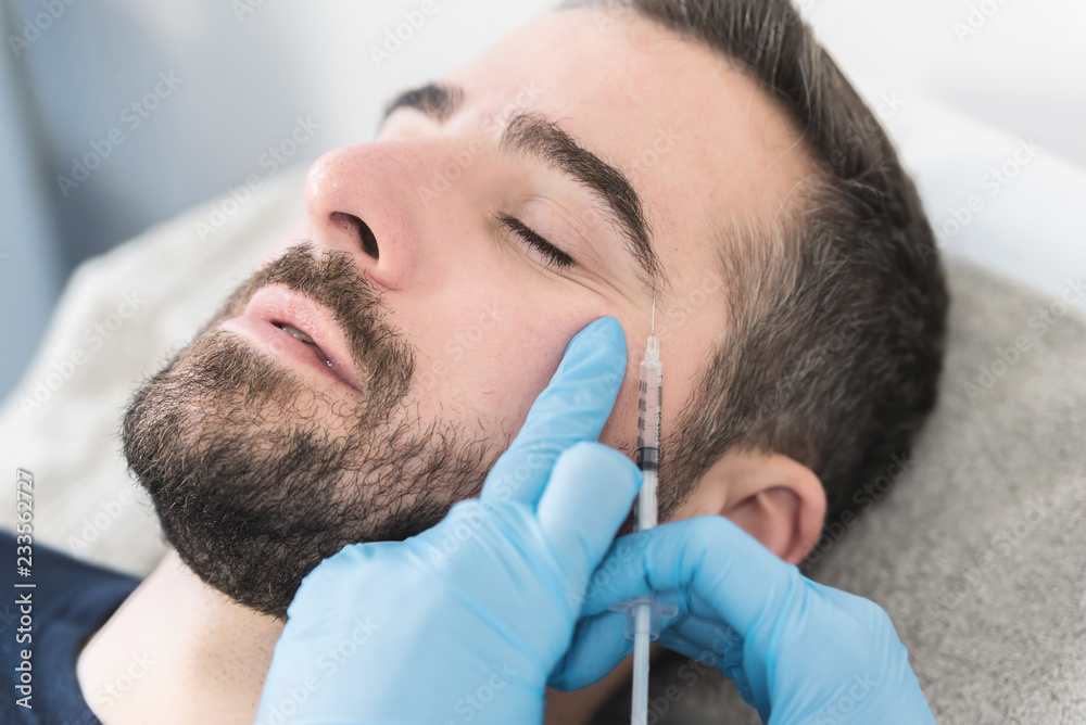 Fototapety, obrazy: Man having facial procedure
