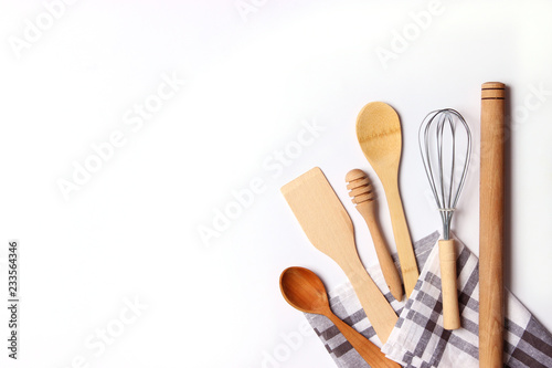 Fototapeta different kitchenware on a light background top view