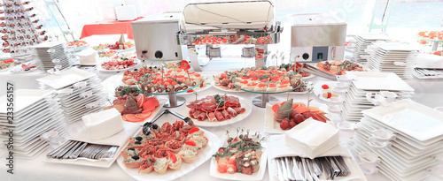 Fototapeta catering table set service with silverware in the glass stemware at restaurant before party obraz