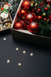 Christmas dark background with red decorative Christmas balls and gifts
