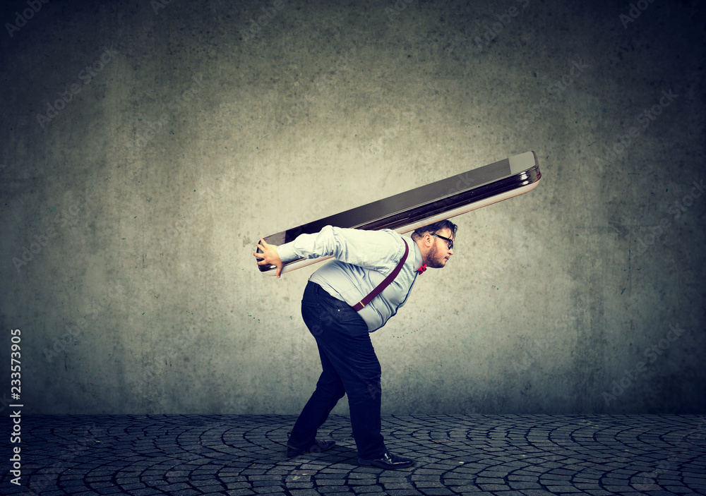 Fototapety, obrazy: business man struggling to carry huge smartphone