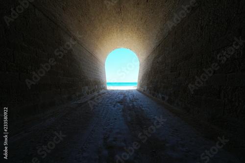 Papiers peints Tunnel A tunnel leads to the seashore, natural scene, Mediterranean sea, Catalonia, Costa Dorada, L'Ametlla de Mar, Tarragona, Spain