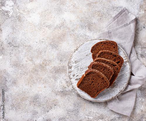 Fresh sliced rye bread on light background