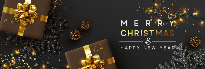 Obraz na PlexiChristmas banner. Background Xmas design of sparkling lights garland, with realistic gifts box, black snowflake and glitter gold confetti. Horizontal christmas poster, greeting cards, headers, website