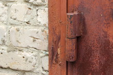 Old Rusty Iron Hinge On Garage Door Close-up - Security, Theft Protection
