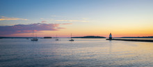 Panorama Sunrise Of A Harbor With Sailboats And Spring Point Ledge Lighthouse