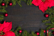 Dark Rustic Wooden Table Background With Christmas Decoration And Fir Frame. Top View With Free Space For Copy Text