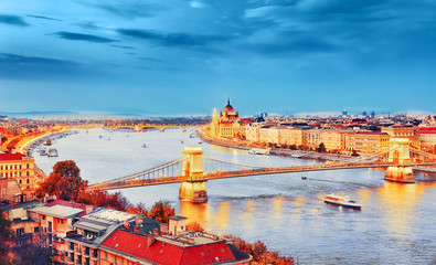 Fototapeta na wymiar The creative processed landscape photography of Budapest city, view on Chain Bridge and Parliament Building over Danube river delta - the Golden Town beneath the Blue Sky - concept of Dream city.